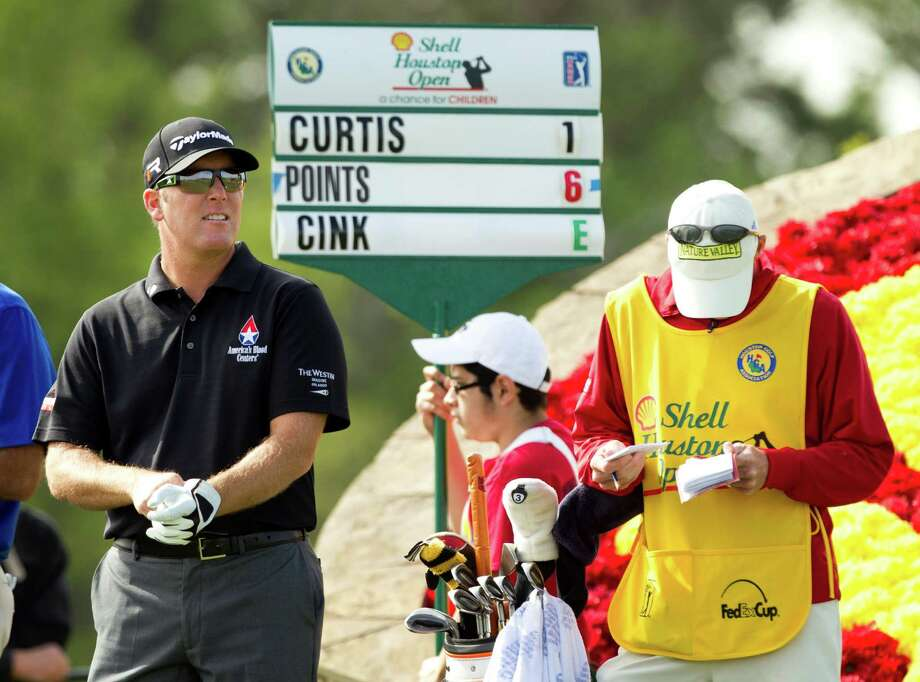 After missing seven of eight cuts this year, a red number was a welcome sight for D.A. Points, left, during Thursday's round. Photo: Brett Coomer, Staff / © 2013 Houston Chronicle