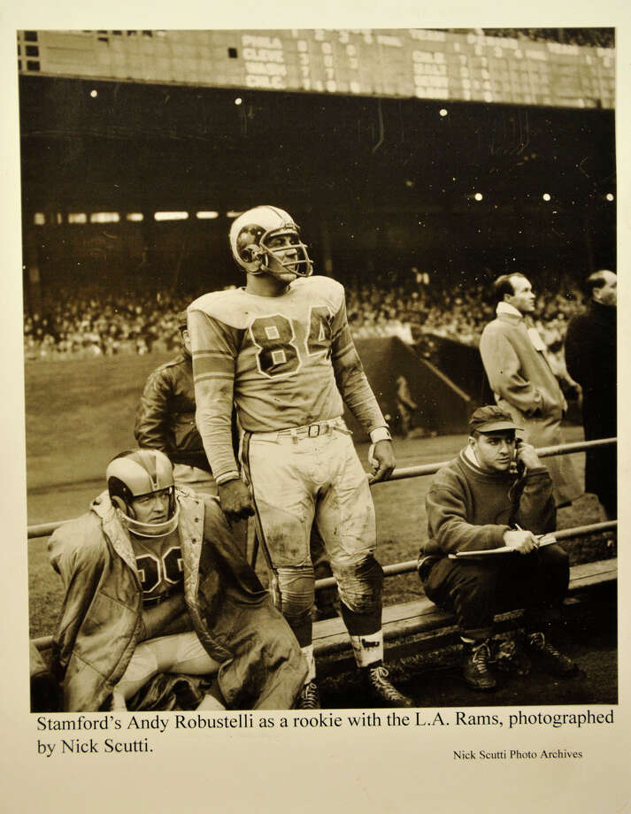 An old photo of Andy Robustelli when he played for the Los Angeles Rams is shown on display at the Stamford Historical Society on Thursday, March 28, 2013. The exhibit Forging a Community: Stamford on the Gridiron and on the Diamond 1860-1975 is currently on show at the Stamford Historical Society. Photo: Jason Rearick / The (Stamford) Advocate
