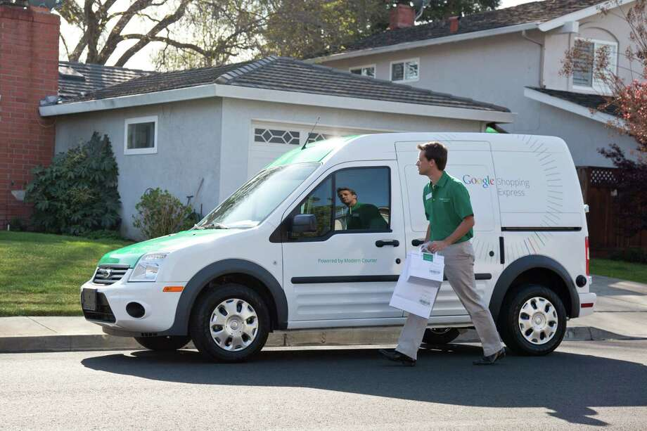 A Google Shopping Express van is shown in this undated photo provided by Google. The search engine leader is taking tentative steps into the speedy delivery of online shopping purchases. Photo: Nick And Laura Allen / Associated Press