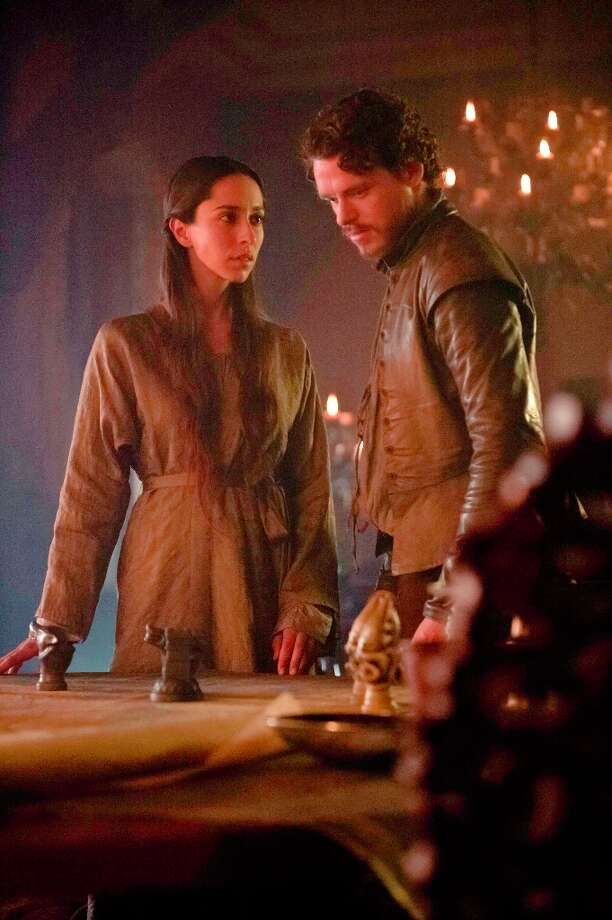 Oona O'Neill as Talisa Maegyr and Richard Madden as Robb Stark in Game of Thrones.