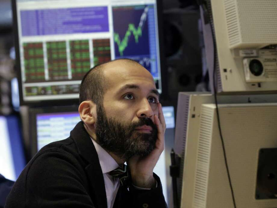Specialist Fabian Caceres works at his post on the floor of the New York Stock Exchange. The S&P 500 might generate fewer headlines than the narrower Dow Jones, but it's the market gauge favored by professional investors. Photo: Richard Drew / Associated Press