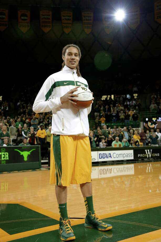 "Baylor 's Brittney Griner (42) holds a ball engraved with ""3000 Career Points"" marking her total scoring points as a NCAA basketball player during a pregame ceremony before an college basketball game against Texas Saturday, Feb. 23, 2013, in Waco, Texas. Griner scored her 3000th point on Feb. 18, 2013 in a game against UCONN. (AP Photo/Tony Gutierrez) Photo: Tony Gutierrez, STF / AP"