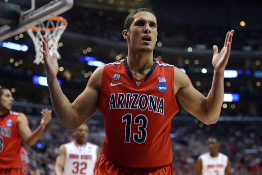 LOS ANGELES, CA - MARCH 28:  Nick Johnson #13 of the Arizona Wildcats reacts in the second half while taking on the Ohio State Buckeyes during the West Regional of the 2013 NCAA Men's Basketball Tournament at Staples Center on March 28, 2013 in Los Angeles, California. Photo: Harry How, Getty Images / 2013 Getty Images