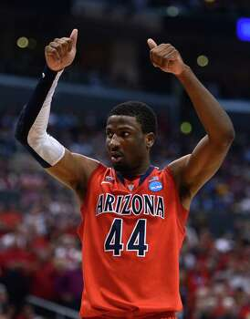 LOS ANGELES, CA - MARCH 28:  Solomon Hill #44 of the Arizona Wildcats calls for a jump ball in the second half while taking on the Ohio State Buckeyes during the West Regional of the 2013 NCAA Men's Basketball Tournament at Staples Center on March 28, 2013 in Los Angeles, California. Photo: Harry How, Getty Images / 2013 Getty Images