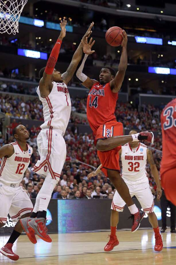 LOS ANGELES, CA - MARCH 28:  Solomon Hill #44 of the Arizona Wildcats goes up for a shot against Deshaun Thomas #1 of the Ohio State Buckeyes in the second half during the West Regional of the 2013 NCAA Men's Basketball Tournament at Staples Center on March 28, 2013 in Los Angeles, California. Photo: Jeff Gross, Getty Images / 2013 Getty Images