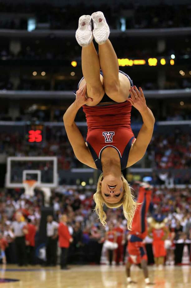 LOS ANGELES, CA - MARCH 28:  An Arizona Wildcats cheerleader performs during a break in the game against the Ohio State Buckeyes during the West Regional of the 2013 NCAA Men's Basketball Tournament at Staples Center on March 28, 2013 in Los Angeles, California. Photo: Jeff Gross, Getty Images / 2013 Getty Images