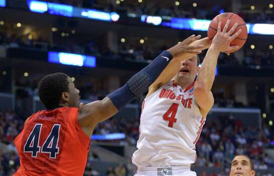 Arizona's Solomon Hill, left, defends Ohio State's Aaron Craft during the second half of a West Regional semifinal in the NCAA men's college basketball tournament, Thursday, March 28, 2013, in Los Angeles. (AP Photo/Mark J. Terrill) Photo: Mark J. Terrill, Associated Press / AP