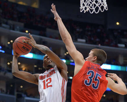Ohio State's Sam Thompson, left, takes aim against Arizona's Kaleb Tarczewski during the second half of a West Regional semifinal in the NCAA men's college basketball tournament, Thursday, March 28, 2013, in Los Angeles. (AP Photo/Mark J. Terrill) Photo: Mark J. Terrill, Associated Press / AP
