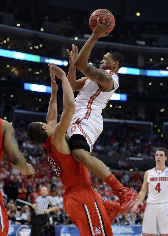 LOS ANGELES, CA - MARCH 28:  Lenzelle Smith, Jr. #32 of the Ohio State Buckeyes goes up for a shot as Nick Johnson #13 of the Arizona Wildcats is called for a block in the second half during the West Regional of the 2013 NCAA Men's Basketball Tournament at Staples Center on March 28, 2013 in Los Angeles, California. Photo: Harry How, Getty Images / 2013 Getty Images