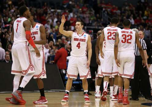 LOS ANGELES, CA - MARCH 28:  Aaron Craft #4 of the Ohio State Buckeyes celebrates with teammates in the second half while taking on the Arizona Wildcats during the West Regional of the 2013 NCAA Men's Basketball Tournament at Staples Center on March 28, 2013 in Los Angeles, California. Photo: Jeff Gross, Getty Images / 2013 Getty Images