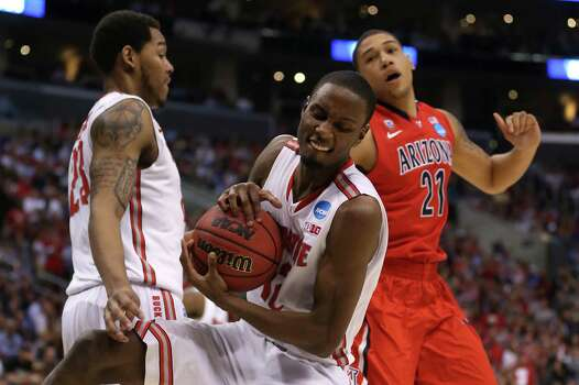 LOS ANGELES, CA - MARCH 28:  Sam Thompson #12 of the Ohio State Buckeyes grabs a rebound in front of Brandon Ashley #21 of the Arizona Wildcats in the second half during the West Regional of the 2013 NCAA Men's Basketball Tournament at Staples Center on March 28, 2013 in Los Angeles, California. Photo: Jeff Gross, Getty Images / 2013 Getty Images