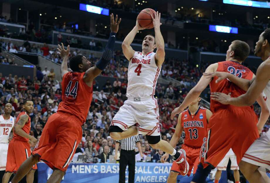 LOS ANGELES, CA - MARCH 28:  Aaron Craft #4 of the Ohio State Buckeyes goes up for a shot against Solomon Hill #44 of the Arizona Wildcats in the second half during the West Regional of the 2013 NCAA Men's Basketball Tournament at Staples Center on March 28, 2013 in Los Angeles, California. Photo: Harry How, Getty Images / 2013 Getty Images
