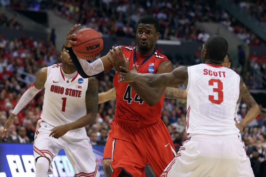 LOS ANGELES, CA - MARCH 28:  Solomon Hill #44 of the Arizona Wildcats drives on Shannon Scott #3 of the Ohio State Buckeyes in the second half during the West Regional of the 2013 NCAA Men's Basketball Tournament at Staples Center on March 28, 2013 in Los Angeles, California. Photo: Jeff Gross, Getty Images / 2013 Getty Images