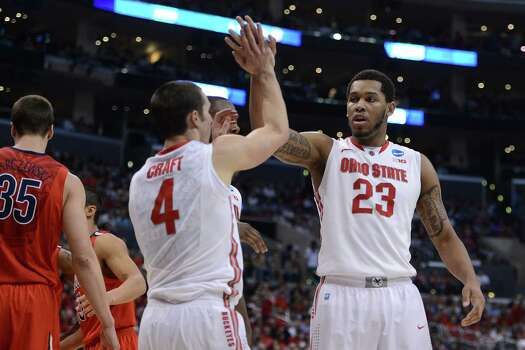 LOS ANGELES, CA - MARCH 28:  Amir Williams #23 celebrates with teammate Aaron Craft #4 of the Ohio State Buckeyes in the second half against the Arizona Wildcats during the West Regional of the 2013 NCAA Men's Basketball Tournament at Staples Center on March 28, 2013 in Los Angeles, California. Photo: Harry How, Getty Images / 2013 Getty Images