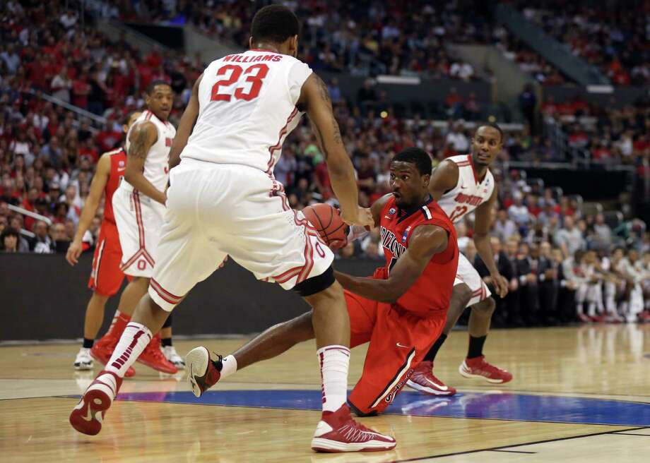 LOS ANGELES, CA - MARCH 28:  Solomon Hill #44 of the Arizona Wildcats passes the ball against Amir Williams #23 of the Ohio State Buckeyes in the second half during the West Regional of the 2013 NCAA Men's Basketball Tournament at Staples Center on March 28, 2013 in Los Angeles, California. Photo: Jeff Gross, Getty Images / 2013 Getty Images