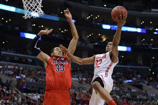 LOS ANGELES, CA - MARCH 28:  Lenzelle Smith Jr. #32 of the Ohio State Buckeyes goes up for a shot against Grant Jerrett #33 of the Arizona Wildcats in the second half during the West Regional of the 2013 NCAA Men's Basketball Tournament at Staples Center on March 28, 2013 in Los Angeles, California. Photo: Harry How, Getty Images / 2013 Getty Images