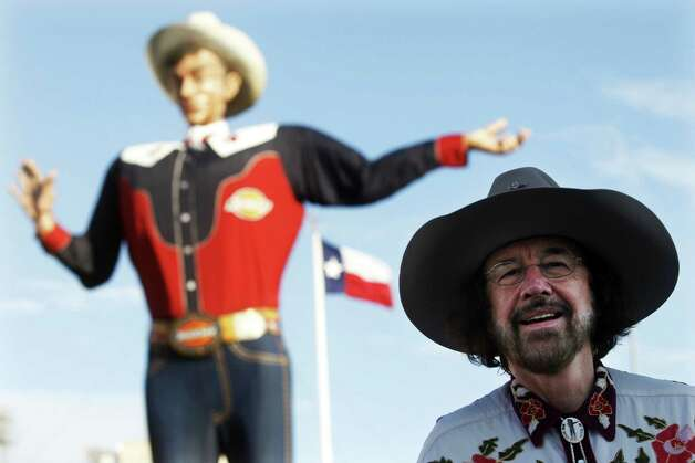 Bill Bragg is seen in front of Big Tex before the fire that destroyed the icon last September. He was the voice of Big Tex for 11 years and says he's shocked by the decision not to renew his contract. Photo: Associated Press