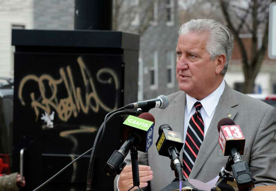 Albany Mayor Jerry Jennings unveiled a new graffiti fighting app called Graffiti Buster Thursday morning, March 28, 2013, in Albany, N.Y. The app works on smart phones and iPads. It allows participants to alert the city of any graffiti. (Skip Dickstein/Times Union) Photo: SKIP DICKSTEIN / 10021774A