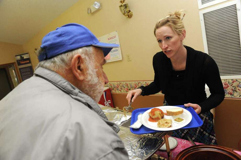 Church volunteer Jean Stabinski of Canajohaire dishes out borscht, cheese pirogi, Pilmeni and stuffed cabbage a Easter and ethnic food fair at the Russian Orthodox Community Center on Thursday March 28, 2013 in Colonie, N.Y. The Russian Orthodox Easter falls on May 5th this year.(Michael P. Farrell/Times Union) Photo: Michael P. Farrell