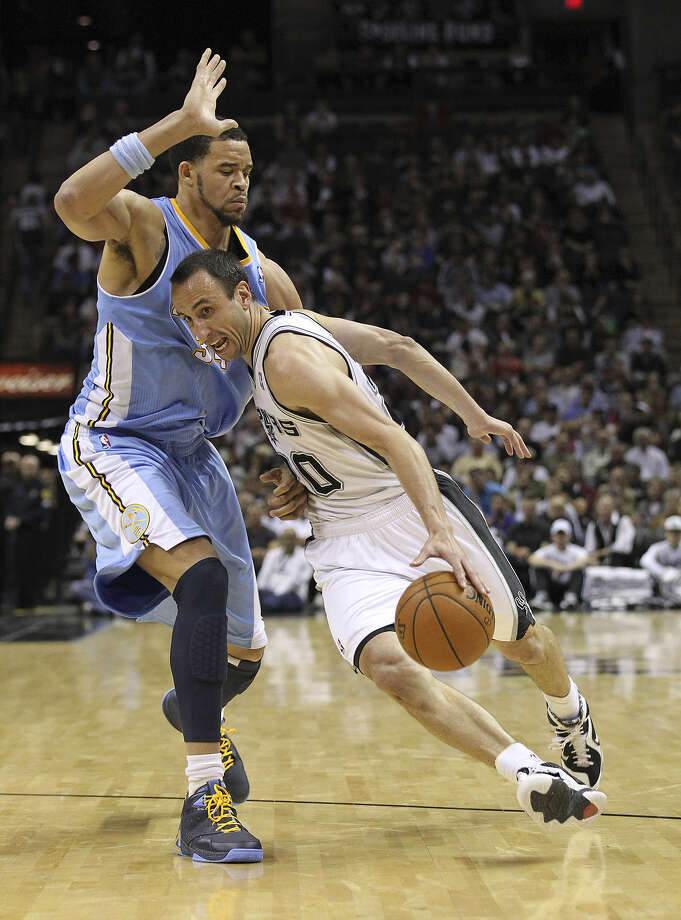 "Manu Ginobili, driving past Denver's JaVale McGee on Wednesday, said he ""really didn't care"" that Miami's winning streak was stopped before the Heat visited the AT&T Center on Sunday. ""We usually don't look at teams in the East. The West is tough enough,"" he said. Photo: Kin Man Hui / San Antonio Express-News"