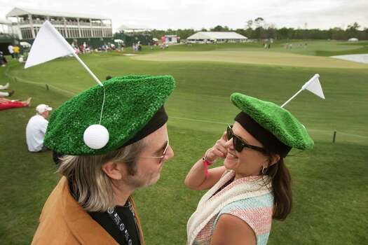 Lonnie, left, and Polly Cooper get into the spirit of the occasion next to the 18th green on Thursday at  Redstone Golf Club. Photo: Brett Coomer, Staff / © 2013 Houston Chronicle