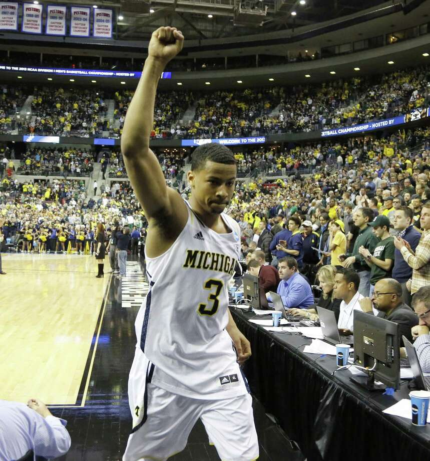 "Michigan's Trey Burke said former Wolverine Jimmy King told the current players to just ""have fun and play your game."" Photo: Julian H. Gonzalez / Detroit Free Press"