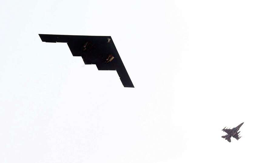 U.S. Air Force B-2 stealth bomber, left, flies over near Osan U.S. Air Base in Pyeongtaek, south of Seoul, South Korea, Thursday, March 28, 2013. A day after shutting down a key military hotline, Pyongyang instead used indirect communications with Seoul to allow South Koreans to cross the heavily armed border and work at a factory complex that is the last major symbol of inter-Korean cooperation. (AP Photo/Lee Jung-hun, Yonhap) KOREA OUT Photo: Lee Jung-hun