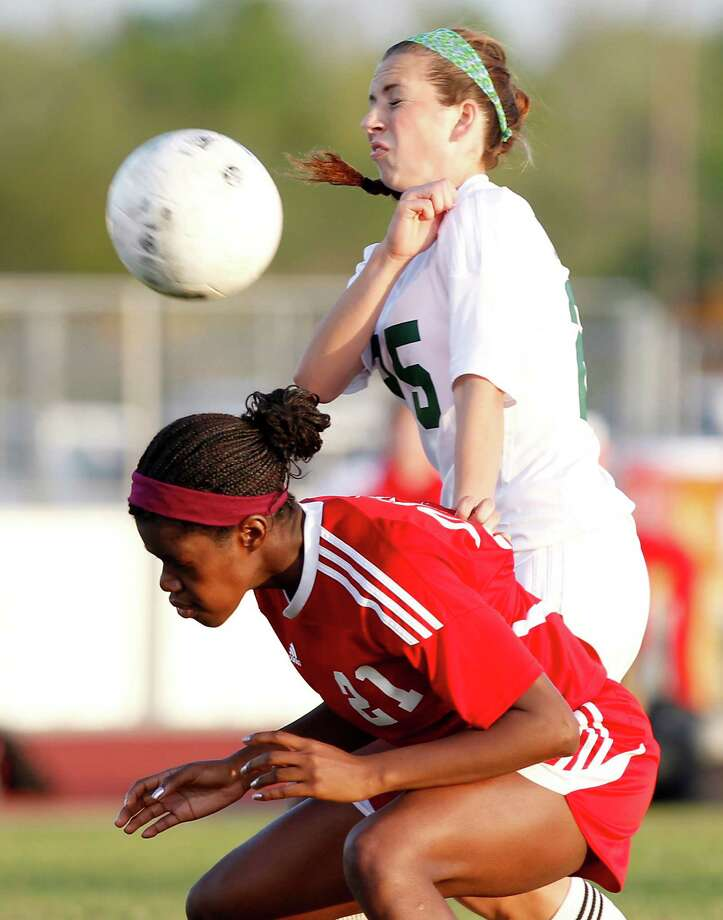 3/28/13:  Kira Zapalac #25 of the Clear Falls Knights goes over Lanah Kweme #21 of the Dulles Lady Vikings in the Region III Bi-District Girls Soccer Playoffs at Manvel, Texas. Photo: Thomas B. Shea, Houston Chronicle / © 2013 Thomas B. Shea