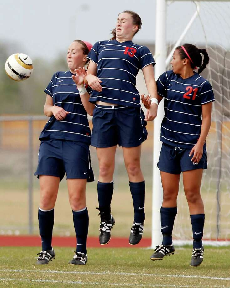 3/28/13:  Clear Lake's Emily Brown #10, Dayla Larocque #13 and natalie Miroballi #21 block a Fort Bend Austin's free kick in the Region III Bi-District Girls Soccer Playoffs at Manvel, Texas. Photo: Thomas B. Shea, Houston Chronicle / © 2013 Thomas B. Shea