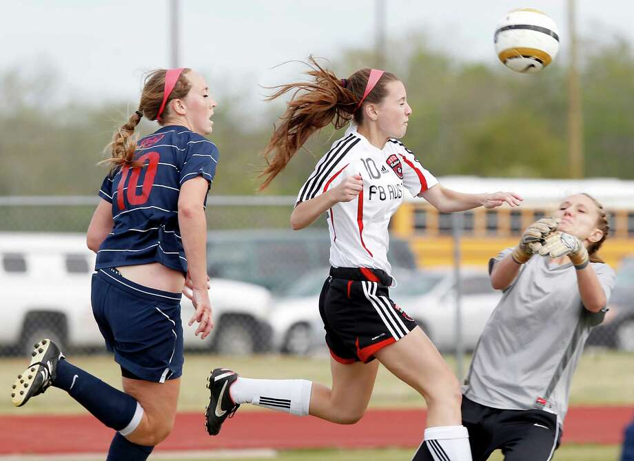 3/28/13:  Clear Lake's goalie Michelle Constanzi #1 makes a save against  For Bend Austin's iSarah Turpin #10 in the Region III Bi-District Girls Soccer Playoffs at Manvel, Texas. Photo: Thomas B. Shea, Houston Chronicle / © 2013 Thomas B. Shea