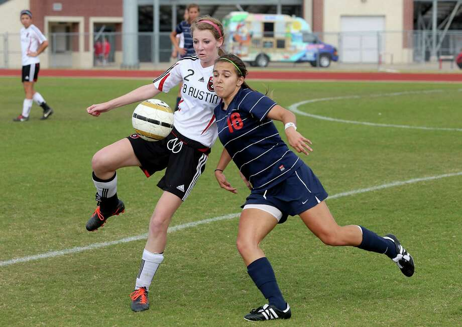 3/28/13:  Clear Lake's Kal;i Bourbonais #16 leans in against Fort Bend Austin's  Lauren Byrne #2 in the Region III Bi-District Girls Soccer Playoffs at Manvel, Texas. Photo: Thomas B. Shea, Houston Chronicle / © 2013 Thomas B. Shea