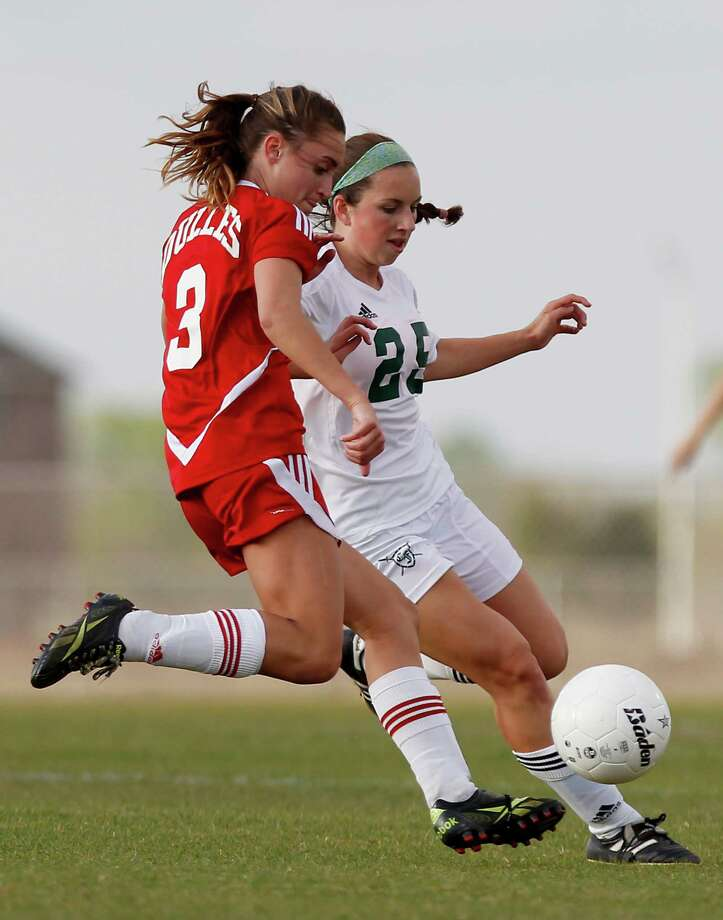 3/28/13:  Kira Zapalac #25 of the Clear Falls Knights defends against Jennifer Walker #3 of the Dulles Lady Vikings in the Region III Bi-District Girls Soccer Playoffs at Manvel, Texas. Photo: Thomas B. Shea, Houston Chronicle / © 2013 Thomas B. Shea