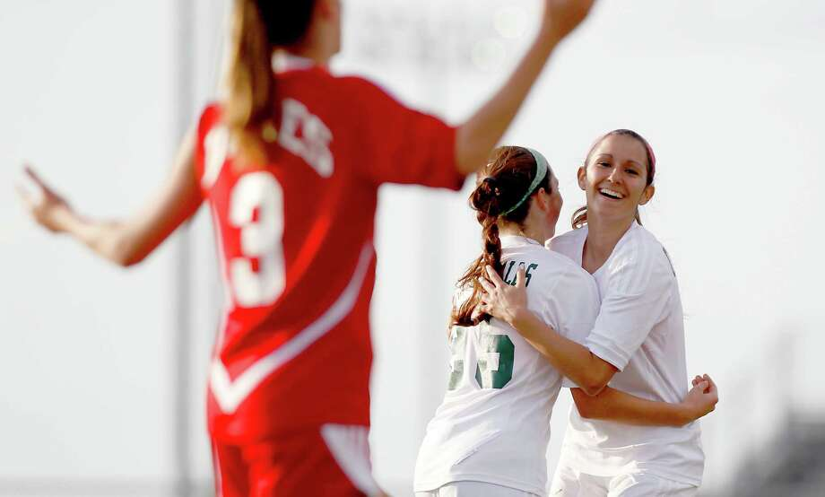 3/28/13:  Hayley Durden #3 celebrates her goal with Kira Zapalac #25 of the Clear Falls Knights against the Dulles Lady Vikings in the Region III Bi-District Girls Soccer Playoffs at Manvel, Texas. Photo: Thomas B. Shea, Houston Chronicle / © 2013 Thomas B. Shea