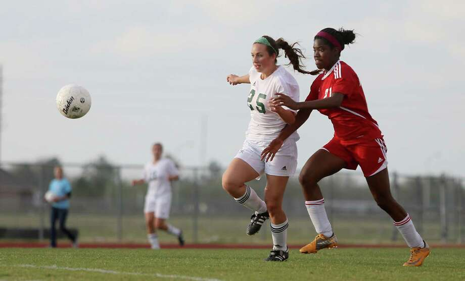 3/28/13:  Kira Zapalac #25 of the Clear Falls Knights dribbles the ball in front of Lanah Kweme #21 of the Dulles Lady Vikings in the Region III Bi-District Girls Soccer Playoffs at Manvel, Texas. Photo: Thomas B. Shea, Houston Chronicle / © 2013 Thomas B. Shea