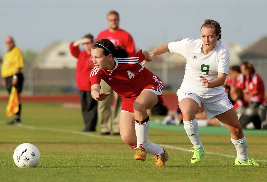 Clear Falls 4, Dulles 03/28/13:  Leah Draper #9 of the Clear Falls Knights defends against Courtney Ericson #4 of the Dulles Lady Vikings in the Region III Bi-District Girls Soccer Playoffs at Manvel, Texas. Photo: Thomas B. Shea, Houston Chronicle / © 2013 Thomas B. Shea