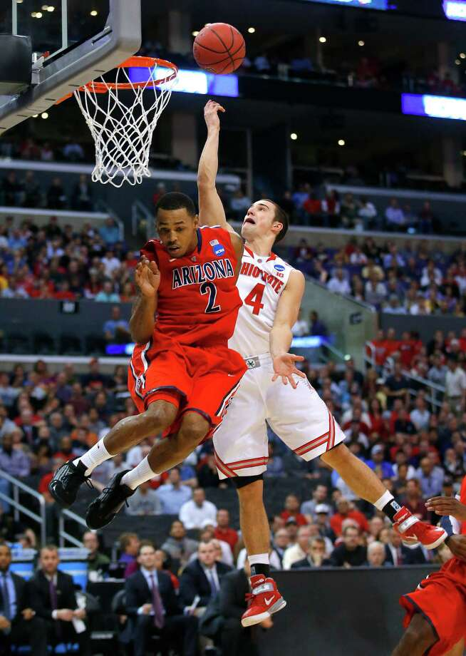 Ohio State's Aaron Craft (4) shoots next to Arizona's Mark Lyons (2) during the first half of a West Regional semifinal in the NCAA men's college basketball tournament, Thursday, March 28, 2013, in Los Angeles. (AP Photo/Jae C. Hong) Photo: Jae C. Hong