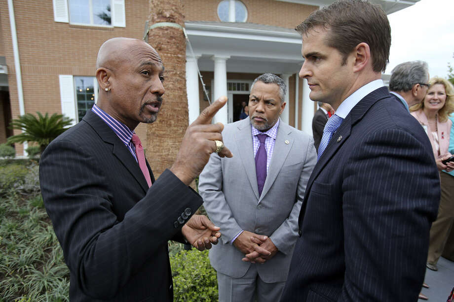 Montel Williams talks with Tommy Sowers as Ranger Jones listens at the dedication of the new facility.