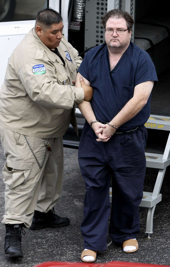 Edward Merlin Olson (right) was working for Methodist Hospital when the FBI arrested him in 2010. Photo: San Antonio Express-News / File Photo