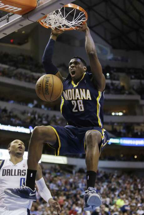 Former Spurs center Ian Mahinmi dunks for two of his nine points during Indiana's 103-78 victory. Photo: Mike Fuentes / Associated Press