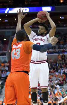 Indiana forward Christian Watford (2) shoots a jumper over Syracuse forward James Southerland (43) in the second half of an NCAA Tournament East Regional semifinal at the Verizon Center in Washington, D.C., Thursday, March 28, 2013. (Harry E. Walker/MCT) Photo: Harry E. Walker, McClatchy-Tribune News Service / Harry E. Walker, Copyright 2012