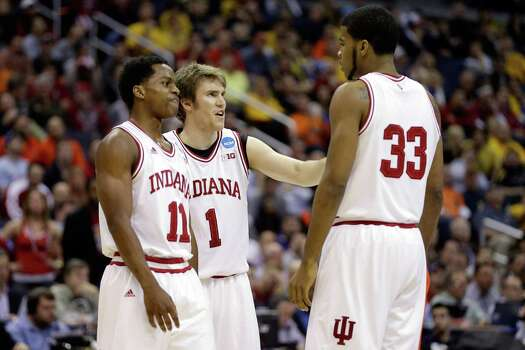 WASHINGTON, DC - MARCH 28:  Yogi Ferrell #11, Jordan Hulls #1 and Jeremy Hollowell #33 of the Indiana Hoosiers huddle up against the Syracuse Orange during the East Regional Round of the 2013 NCAA Men's Basketball Tournament at Verizon Center on March 28, 2013 in Washington, DC. Photo: Rob Carr, Getty Images / 2013 Getty Images