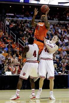 WASHINGTON, DC - MARCH 28:  C.J. Fair #5 of the Syracuse Orange shoots the ball over Victor Oladipo #4 of the Indiana Hoosiers and Cody Zeller #40 of the Indiana Hoosiers during the East Regional Round of the 2013 NCAA Men's Basketball Tournament at Verizon Center on March 28, 2013 in Washington, DC. Photo: Rob Carr, Getty Images / 2013 Getty Images