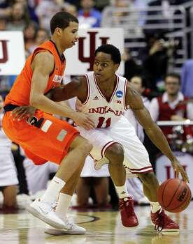 Indiana guard Yogi Ferrell (11) drives around Syracuse guard Michael Carter-Williams, left, during the second half of an East Regional semifinal in the NCAA college basketball tournament, Thursday, March 28, 2013, in Washington. (AP Photo/Pablo Martinez Monsivais) Photo: Pablo Martinez Monsivais, Associated Press / AP