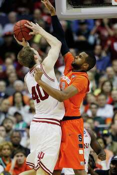 Syracuse guard Griffin Hoffmann (13) blocks a shot by Indiana forward Cody Zeller (40) during the second half of an East Regional semifinal in the NCAA college basketball tournament, Thursday, March 28, 2013, in Washington. (AP Photo/Pablo Martinez Monsivais) Photo: Pablo Martinez Monsivais, Associated Press / AP