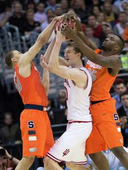 Syracuse guard Brandon Triche (20), left, and Syracuse forward Rakeem Christmas (25) tie up Indiana forward Cody Zeller (40) in the first half of an NCAA Tournament East Regional semifinal at the Verizon Center in Washington, D.C., Thursday, March 28, 2013. (Harry E. Walker/MCT) Photo: Harry E. Walker, McClatchy-Tribune News Service / Harry E. Walker, Copyright 2012