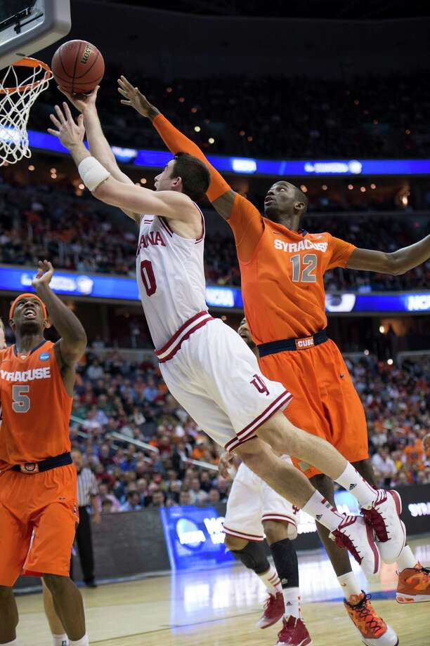 Indiana forward Cody Zeller (40) goes to the hoop with a shot against Syracuse center Baye Keita (12) in the second half of an NCAA Tournament East Regional semifinal at the Verizon Center in Washington, D.C., Thursday, March 28, 2013. (Harry E. Walker/MCT) Photo: Harry E. Walker, McClatchy-Tribune News Service / Harry E. Walker, Copyright 2012