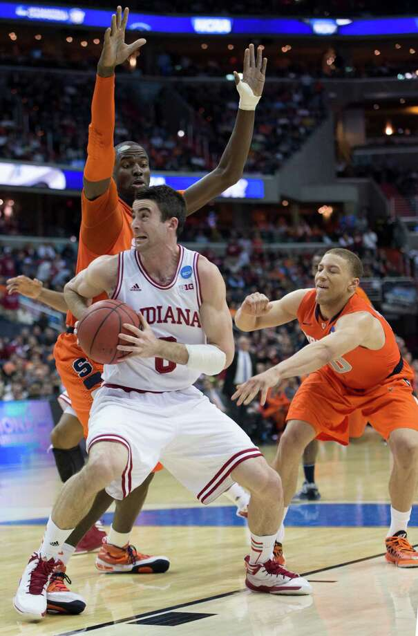 Indiana forward Cody Zeller (40) puts a spin move to the hoop against Syracuse center Baye Keita (12), back, and Syracuse guard Brandon Triche (20) in the second half of an NCAA Tournament East Regional semifinal at the Verizon Center in Washington, D.C., Thursday, March 28, 2013. (Harry E. Walker/MCT) Photo: Harry E. Walker, McClatchy-Tribune News Service / Harry E. Walker, Copyright 2012