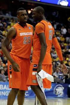 WASHINGTON, DC - MARCH 28:  Rakeem Christmas #25 and Baye Keita #12 of the Syracuse Orange celebrate after a play against the Indiana Hoosiers during the East Regional Round of the 2013 NCAA Men's Basketball Tournament at Verizon Center on March 28, 2013 in Washington, DC. Photo: Rob Carr, Getty Images / 2013 Getty Images