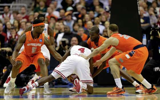WASHINGTON, DC - MARCH 28:  Victor Oladipo #4 of the Indiana Hoosiers fights for the loose ball against Baye Keita #12, Brandon Triche #20 and C.J. Fair #5 of the Syracuse Orange during the East Regional Round of the 2013 NCAA Men's Basketball Tournament at Verizon Center on March 28, 2013 in Washington, DC. Photo: Win McNamee, Getty Images / 2013 Getty Images
