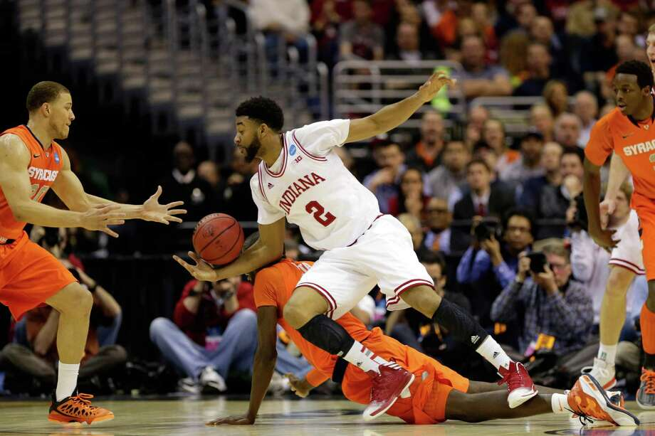 WASHINGTON, DC - MARCH 28:  Christian Watford #2 of the Indiana Hoosiers fights for the loose ball against Baye Keita #12 and Brandon Triche #20 of the Syracuse Orange during the East Regional Round of the 2013 NCAA Men's Basketball Tournament at Verizon Center on March 28, 2013 in Washington, DC. Photo: Win McNamee, Getty Images / 2013 Getty Images